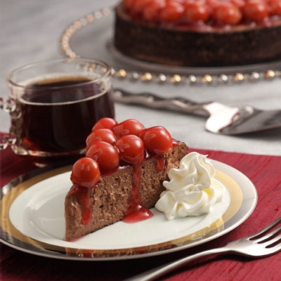 Fudgy Cheesecake with Cherry Sauce