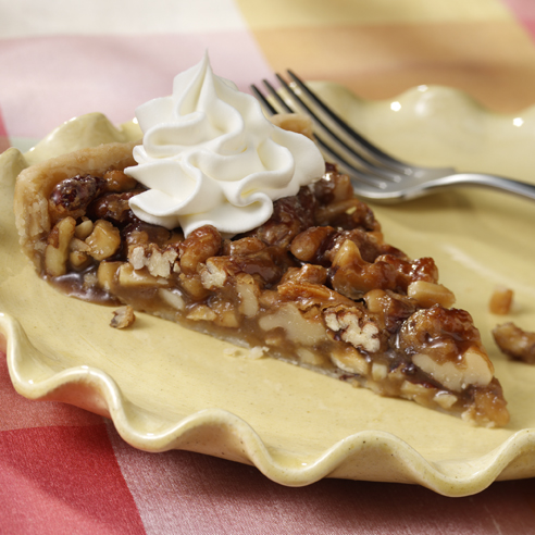 caramel nut tart a rich caramel filling loaded with chopped nuts baked ...