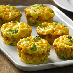 Crustless mini quiches filled with broccoli and corn and topped with ...